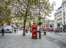 Street in London during day with public phone Stock Photos