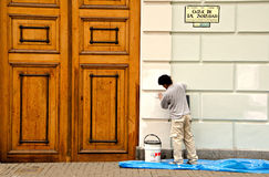 Street loneliness. Man painting wall, Lima Peru Royalty Free Stock Photography