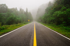 The street. A long foggy street leads to the mountain, Doi Intanont, Chiang Mai, Thailand Stock Photos