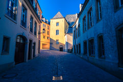 Street in Luxembourg. Sunset rays on an old building royalty free stock image