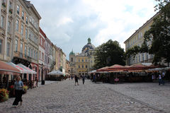 Street in Lvov with cozy caffe Royalty Free Stock Photo