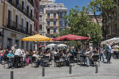 Street in Madrid. Commercial walking street in Madrid with shops , restaurants, historic buildigs and many pedestrians , Spain , Europe Royalty Free Stock Image
