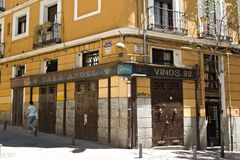 Street in Madrid with the corner bar `Casa Angel`. An old signboard invites you for a glass of wine royalty free stock photo