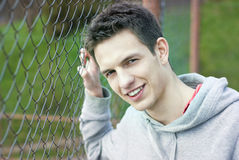 Street man close to fence Stock Photography