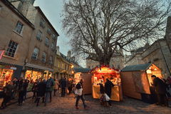 Street Market. BATH, UK - DECEMBER 9, 2015: People visit the Christmas Market in the streets surrounding Bath Abbey. The landmark Somerset city is home to many Stock Photos