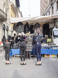 Street Market in Cremona, Italy. A clothing vendor in the weekly open street market, January 2017. Cremona, Italy Royalty Free Stock Images