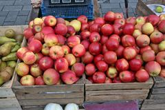Street market of fresh  red garden apples fruits  in wooden boxe Royalty Free Stock Images