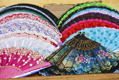 Street market - Hand fan. Street market - Personal accessory - Hand fan - Folding Fan Stock Photo