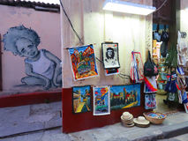 Street market on Havana. Cuba, Havana - 07 April, 2016: a street market in Havana, where different typical authentic goods and souvenirs are sold with flag and Royalty Free Stock Photography
