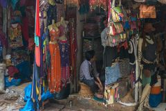 Street Market In India  With Colorful Dress And Bags Hung On The Stand. Royalty Free Stock Images