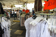 Street market La Ciotat clothes stall stock photo
