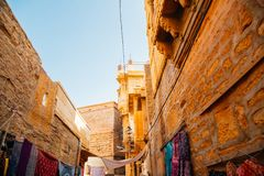 Street market and old buildings at Jaisalmer fort in India royalty free stock photo