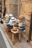 Street market selling hats a in the touristic town. Of France royalty free stock photography