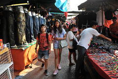 Street Market. Shoppers browse Chatuchak Weekend Market on March 16, 2013 in Bangkok, Thailand. Chatuchak is one of the world's largest markets covering over 35 Royalty Free Stock Photo