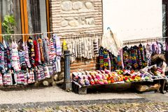 Street market in Signagi town, socks, woolen slippers and bright souvenirs selling on the street.  Georgia stock photos