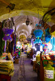 Street Market Tunis, Old Medina Arched Alley -  Colorful Arabic Rugs and Spice Royalty Free Stock Photo