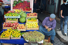 Street market. In Urfa. The sales man  arranges  fruit and vegetables Stock Photos