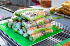 Street market with Vietnamese food and cousine. Spring rolls with seafoods and vegetables stock photo
