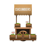 A street market. Wood cart for sale cucumbers. Selling vegetable Royalty Free Stock Images