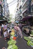 Street Market in Yangon. A vendor sells vegetables at a street vegetable market in downtown Yangon, Myanmar Stock Photos