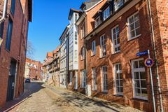 Street with Medieval old brick buildings in Luneburg. Germany stock photography