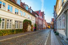 Street with Medieval old brick buildings in Luneburg. Germany royalty free stock photos