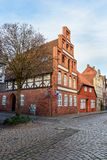 Street with Medieval old brick buildings. Luneburg. Germany stock photos