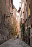 Street in medieval part of Rome, Italy Stock Images