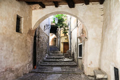 Street in medieval town, Italy. The secret historic road with stairs in Italy Stock Photos