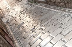 Stone built, polished surface of street in old, medieval town royalty free stock photography