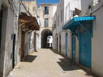 A street in the medina. Tunis. Tunisia. Typical houses with blue windows and doors in the streets in the medina. Tunis. Tunisia Stock Photo