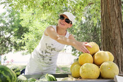 Street melons vendor. Smiling street melons vendor in sunny summer day Stock Photography