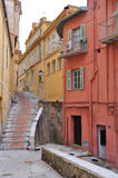 Street in Menton, narrow houses. Narrow streets, magical old part of Menton Stock Photo