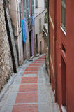 Street in Menton, narrow houses. Narrow streets, magical old part of Menton Royalty Free Stock Photo