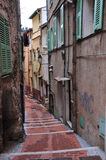 Street in Menton, narrow houses. Narrow streets, magical old part of Menton.a Royalty Free Stock Photo