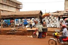 Street Merchants in Kampala, Uganda. KAMPALA, UGANDA - SEPTEMBER 28, 2012. Vendors sell a variety of pots, pans, and chests on the streets of Kampala, Uganda on stock photography