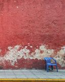 Street of Merida with red wall in Yucatan stock photo