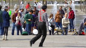 A street mime acts in a city park. stock video footage