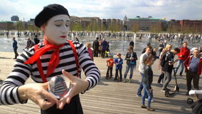 A street mime with a crystal ball stands in city park. stock video footage