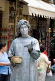 Street mime look. Street mime entertaining tourists on the streets of Granada, Spain Royalty Free Stock Image