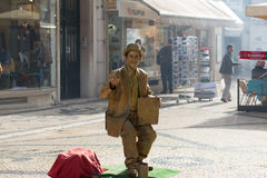 Street mime performer in Lisbon, Portugal. The city is political, economic and cultural center of Portugal Royalty Free Stock Images