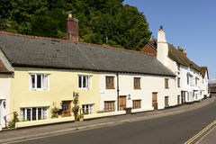 Street at Minehead, Somerset. View of medieval cottages built with  stone  prospecting on a street just in front of sea in historic touristic village of Stock Images