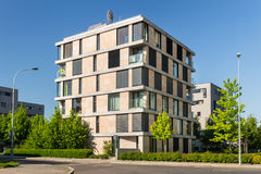 Street with modern block of flats. Photo with blue sky Royalty Free Stock Photo