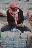 Street money changers of money. HARGEISA, SOMALIA - JANUARY 11, 2010:Main objective of the Bank of Somaliland is to fight inflation. In Hargeisa, practically Royalty Free Stock Image