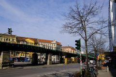 Street mood in multicolored urban berlin area, buildings, bicycle and traffic light