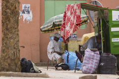 Street in Morocco. Side dirty and destroyed street  citie Taroudant in Morocco. Men on the main square of the city trading food and drinking water Stock Photo
