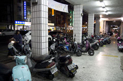 Street of motor bikes. Motorcycles were parked on the sidewalks of the streets of Kaohsiung, Taiwan Stock Images