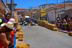 Street Motorcycle Racers. Racing through the town during the Algueña motorcycle road race in Spain stock photos