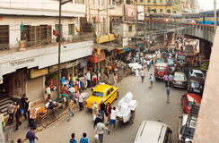 Street movement with cars, trader trolleys and crowd of people in huge asian city Royalty Free Stock Photography