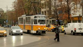 Street with moving traffic and pedestrians in Sofia, Bulgaria, weekday city life. Stock footage stock video